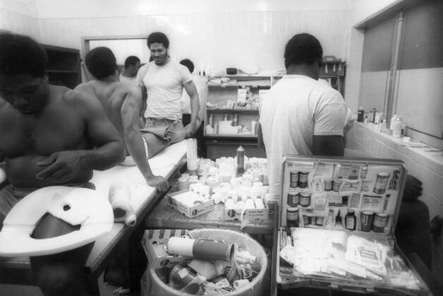 Houston Oilers players get taped up