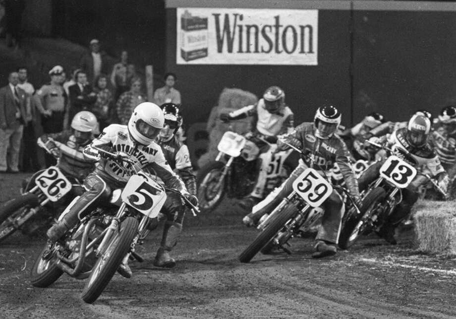 Gary Scott #5 leads the pack while Mickey Fay #59 follows close behind at a TT Motocross event on February 2, 1976 at the Houston Astrodome in Houton, Texas.  Scott lead the pack during the first lap, but was passed by Fay who won.  (Photo by Dozier Mobley/Getty Images) Photo: Dozier Mobley, Getty Images / 1976 Dozier Mobley