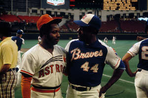 HOUSTON:  Outfielder Jim Wynn #24 of the Houston Astros and  outfielder Hank Aaron #44 of the Atlanta Braves talk before a circa 1970s game at the Astrodome in Houston, Texas. (Photo by Focus on Sport/Getty Images)