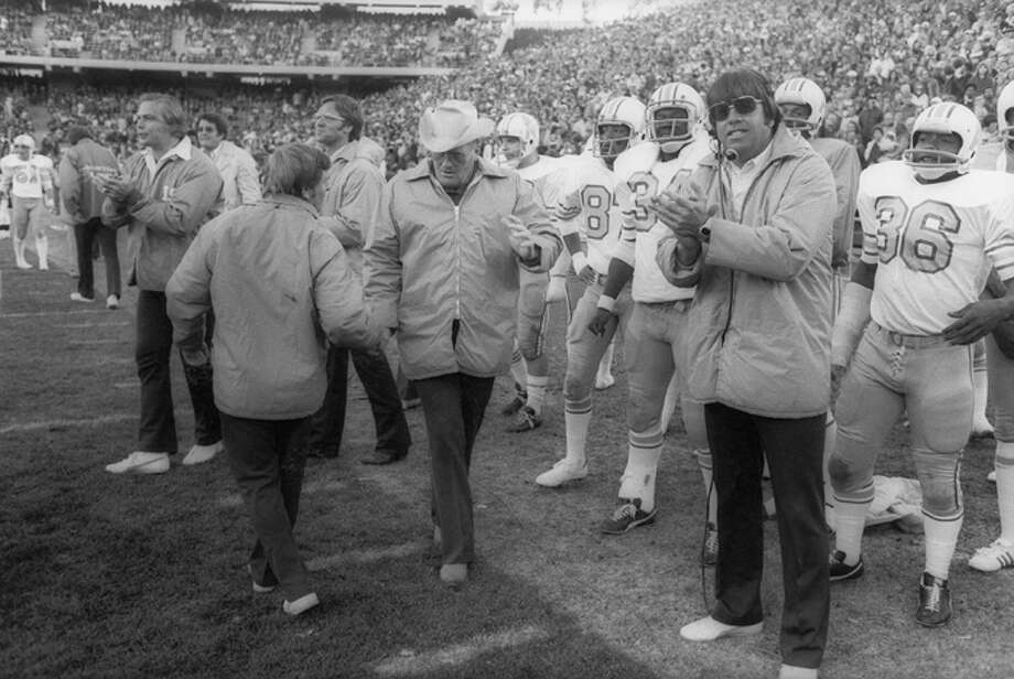 Head coach Bum Phillips of the Houston Oilers receives congratulations near the end of the game against the Oakland Raiders at Oakland Alameda Coliseum on December 14, 1975 in Oakland, California. The Oilers defeated the Raiders 27-26. (Photo by Michael Zagaris/Getty Images) Photo: Michael Zagaris, Getty Images / 1975 Michael Zagaris