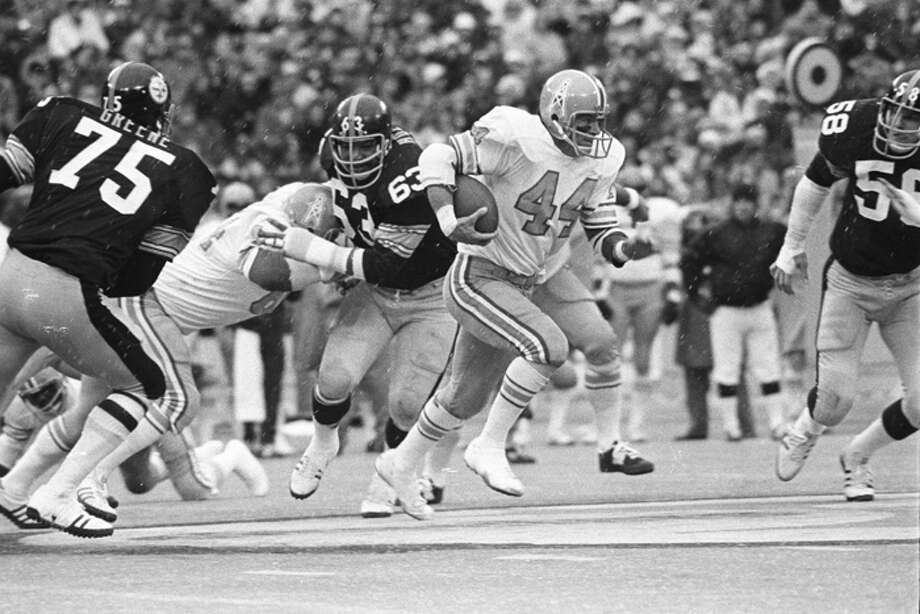 Running back Fred Willis #44 of the Houston Oilers runs against defensive linemen Joe Greene #75 and Ernie Holmes #63 and linebacker Jack Lambert #58 of the Pittsburgh Steelers in the rain and sleet at Three Rivers Stadium on December 1, 1974 in Pittsburgh, Pennsylvania.  (Photo by George Gojkovich/Getty Images) Photo: George Gojkovich, Getty Images / 1974 George Gojkovich