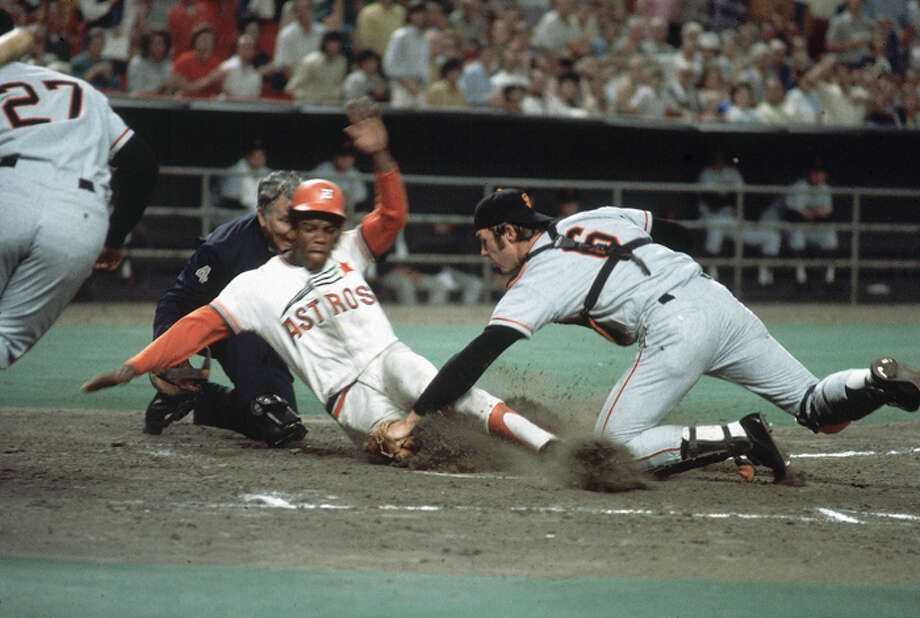 Cesar Cedeno  #28 of the Houston Astros slides into home safely as Fran Healy #6 of the San Francisco Giants tries to make the tag on April 15, 1972 in Houston, Texas.  (Photo by Herb Scharfman/Sports Imagery/Getty Images) Photo: Herb Scharfman/Sports Imagery, Getty Images / 1972 Herb Scharfman/Sports Imagery