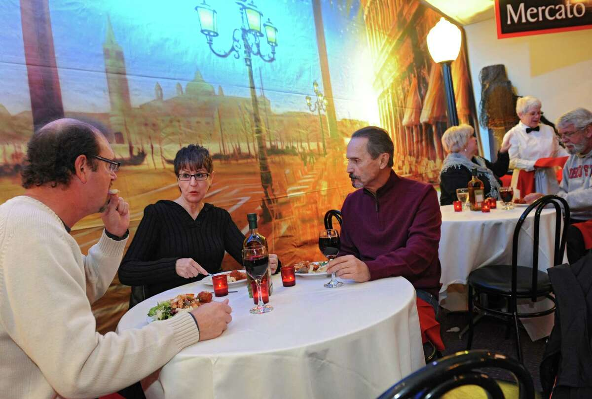 From left, Tony Marotta of Stillwater sits with his friends Judy and John Marchese of Stillwater as Panza's restaurant on Saratoga Lake celebrates their 75th anniversary with a free lunch for the public on Wednesday, Nov. 13, 2013 in Saratoga Springs, N.Y. (Lori Van Buren / Times Union)
