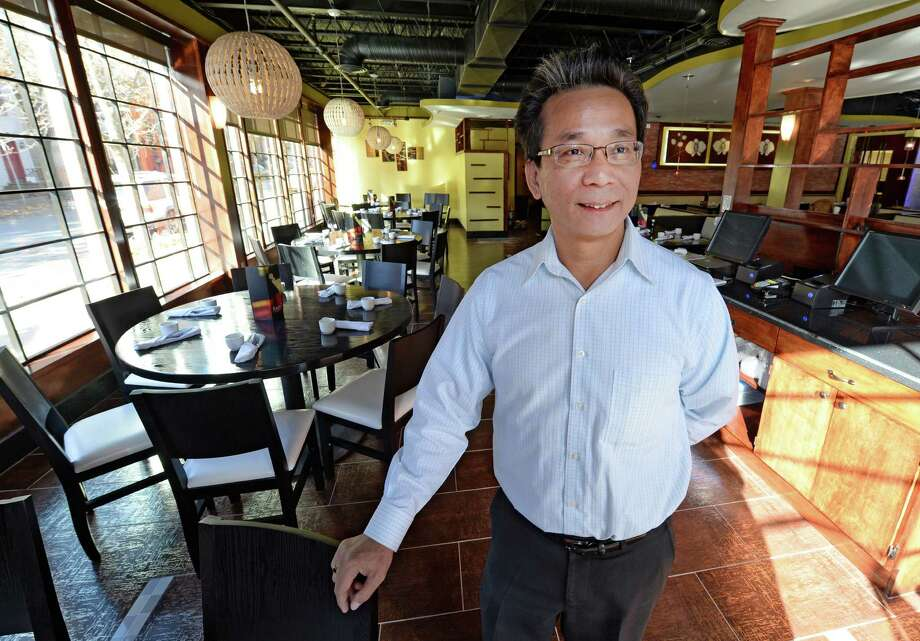Frank Lee owner of Rain, a new contemporary-Chinese restaurant, Wednesday, Nov. 13, 2013, in Albany, N.Y. The restaurant will open Monday Nov. 18.  (Skip Dickstein/Times Union) Photo: SKIP DICKSTEIN / 00024605A