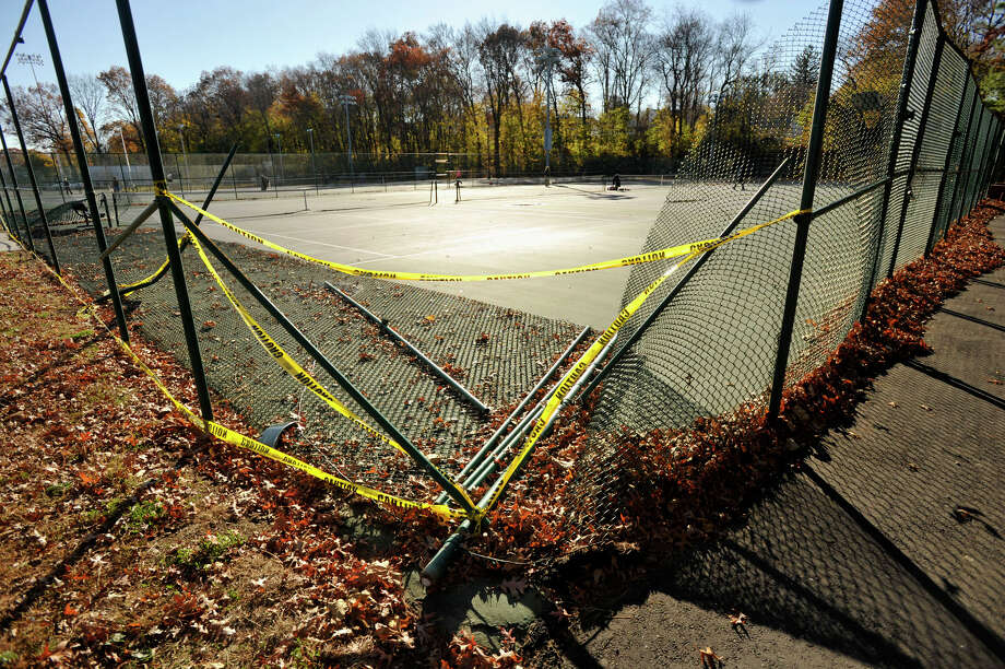 On Nov. 4 a vehicle accidently jumped the curb at the Scalzi Park parking lot striking the tennis court fence causing $2,400 in damages. Photographed at Scalzi Park in Stamford, Conn., on Wednesday, Nov. 13, 2013. Photo: Jason Rearick / Stamford Advocate