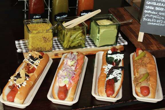 New dogs at the Toyota Center, from left: 	Prime Time Dog, Surf and Turf Dog,	Gourmet Dog,	Build Your Own Dog