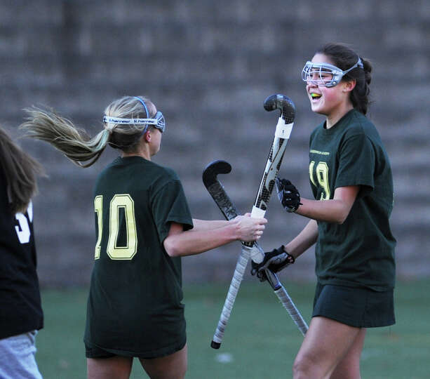 Greenwich Academy's Teddi West (# 10), left, congratualtes teammate, Sarah Frauen (# 19) of Greenwic
