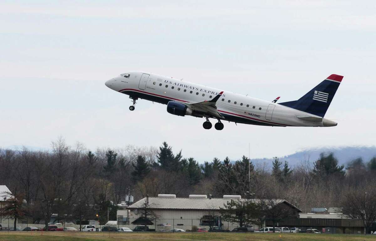 USAriways flight #3237 takes off Thursday lunchtime, April 11, 2013, from Albany International Airport in Colonie , N.Y. A new study predicts that jet travel will be getting a lot bumpier in coming years, as man-made climate change drives increasing turbulence in the upper level atmosphere. The Embraer 175 was destined for Reagan National in Washington D.C. (Will Waldron/Times Union)