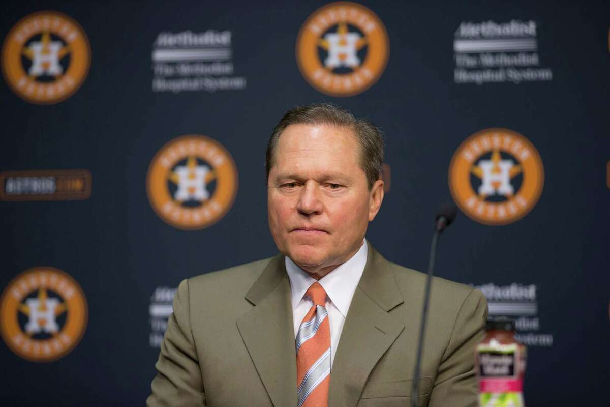Agent Scott Boras sits on stage with his client, newly signed Houston Astros pitcher Mark Appel during a news conference Wednesday, June 19, 2013 in Houston, to announce his signing. Appel was selected with the first overall pick in the 2013 MLB First-Year Player Draft. (AP Photo/David J. Phillip)