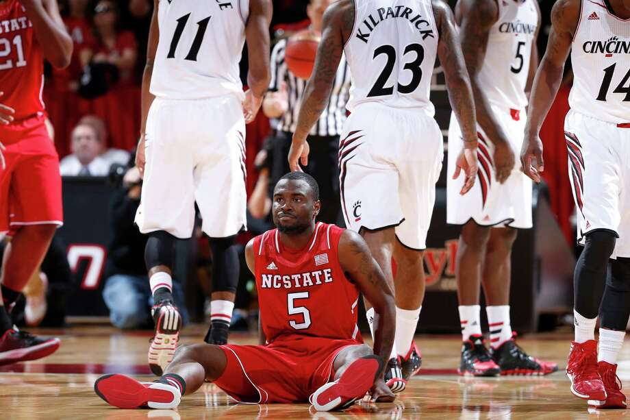 CINCINNATI, OH - NOVEMBER 12: Desmond Lee #5 of the North Carolina State Wolfpack reacts after being called for a foul against the Cincinnati Bearcats during the game at Fifth Third Arena on November 12, 2013 in Cincinnati, Ohio. Cincinnati won 68-57. Photo: Joe Robbins, Getty Images / 2013 Getty Images