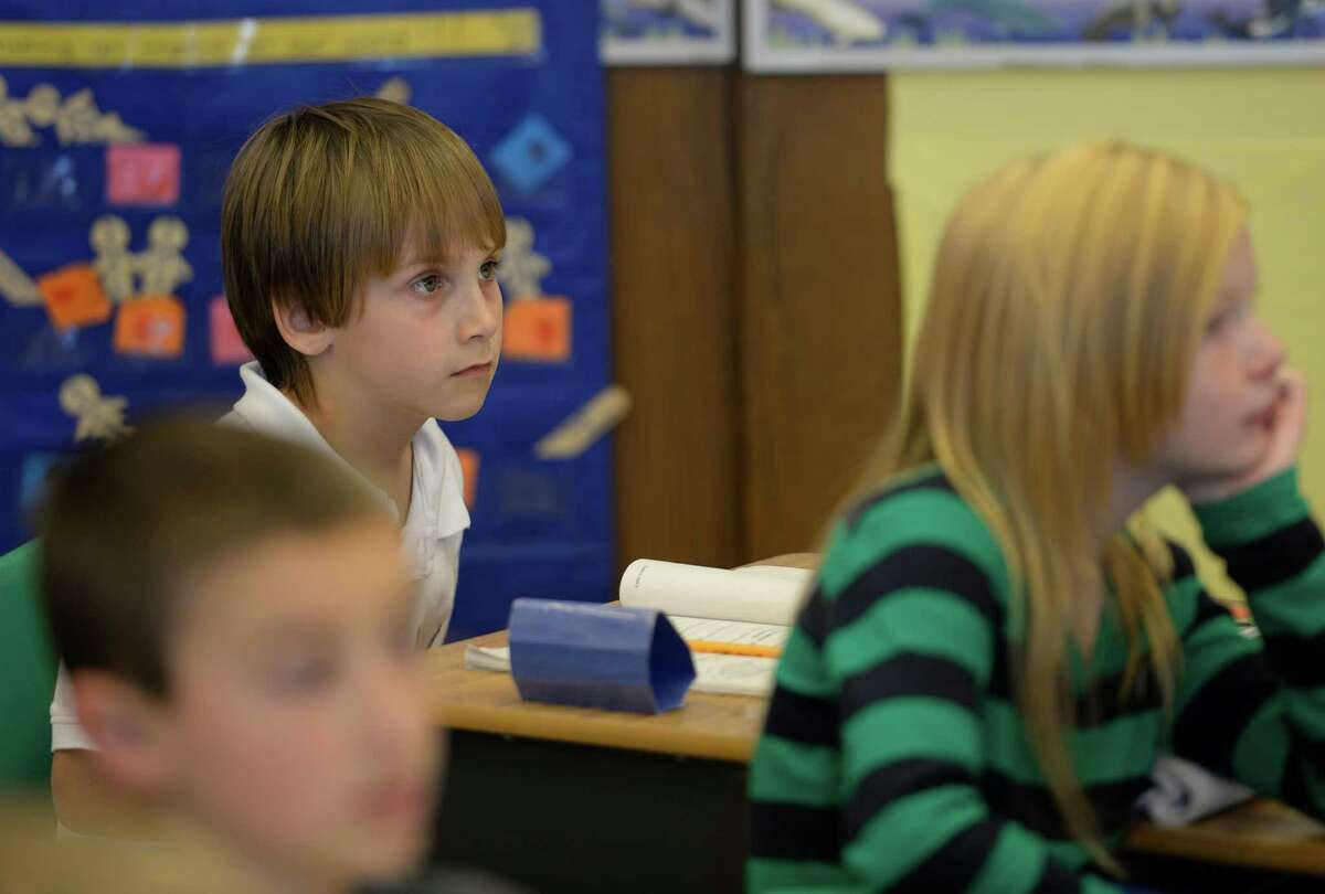 Carter Tripp, 8, a listens intently to instruction from his teacher at the Duanesburg Elementary School Wednesday afternoon Nov. 13, 2013 in Duanesburg, N.Y. Carter started a fundraiser, Carter Cares for Children, with the help of his mother, Nicole, to aid the victims of Super Typhoon Haiyan in the Philippines. Carter's 75-year-old grandfather, Ron Welton, lives just outside of Maasin, a city about 60 miles from Tacloban, the hardest hit area in the Philippines. (Skip Dickstein/Times Union