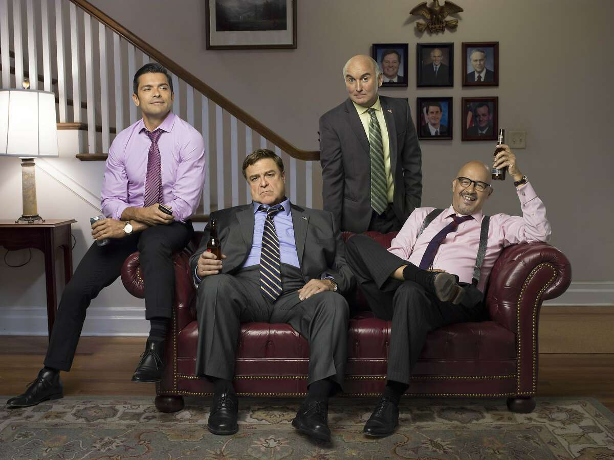 "In this photo providedby Amazon Studios, from left, Mark Consuelos, John Goodman, Matt Malloy and Clark Johnson, star in ""Alpha House"" from Amazon Studios. The series debuts Nov. 15, 2013, on Amazon.com. (AP Photo/Amazon Studios)"