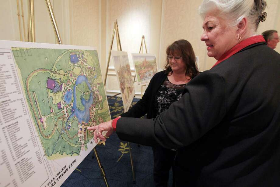 Sandy Seelye and Connie Bloodworth, of East Montgomery County Emprovement District, view the unveiling Wednesday of plans for Grand Texas, a 600-plus-acre theme park proposed to be built in New Caney, a town of about 8,000 30 miles northeast of Houston. Photo: Mayra Beltran / Houston Chronicle