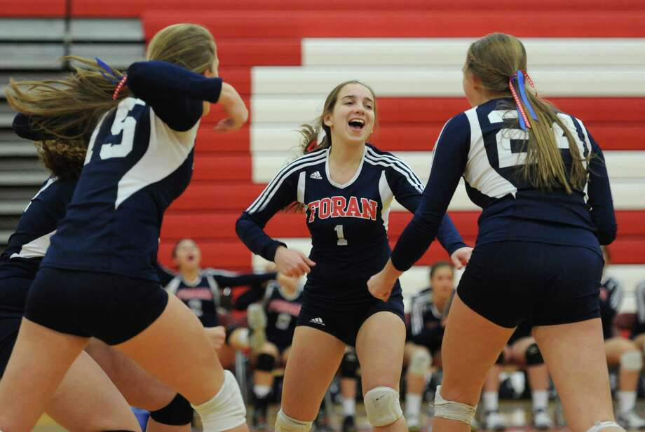 Foran's Kaylee Ciolino (1) celebrates after a point in the class M girls volleyball semifinal game between Foran and Rocky Hill at Pomperaug High School in Southbury, Conn. on Wednesday, Nov. 13, 2013.  Foran won 3-1 (25-14, 13-25, 25-22, 25-22), advancing to the state championship game. Photo: Tyler Sizemore / The News-Times