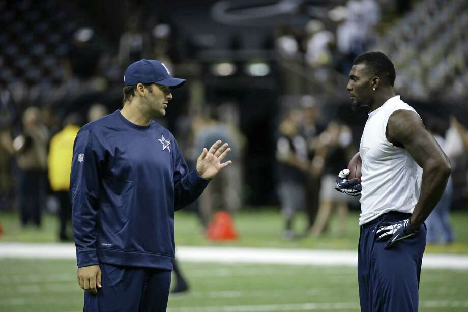 Quarterback Tony Romo (left) targeted Dez Bryant just twice in the Cowboys' loss to the Saints, with the wide receiver's lone catch going for 44 yards. Photo: Dave Martin / Associated Press