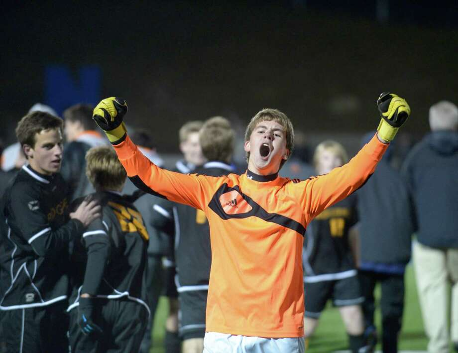 Ridgefield's goalie Nicholas Steer celebrates their win over Xavier , 2-1, in the Conn High School class LL boys soccer semi-final game played at Newtown High School, Newtown, Conn, on Wednesday night, November 13, 2013. Photo: H John Voorhees III / The News-Times Freelance