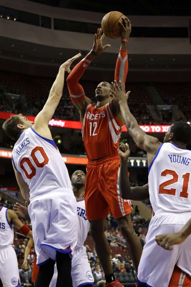 Nov. 13: 76ers 123, Rockets 117 (OT)   Dwight Howard (12) goes up for a shot against Spencer Hawes (00) and Thaddeus Young (21). Photo: Matt Slocum, Associated Press