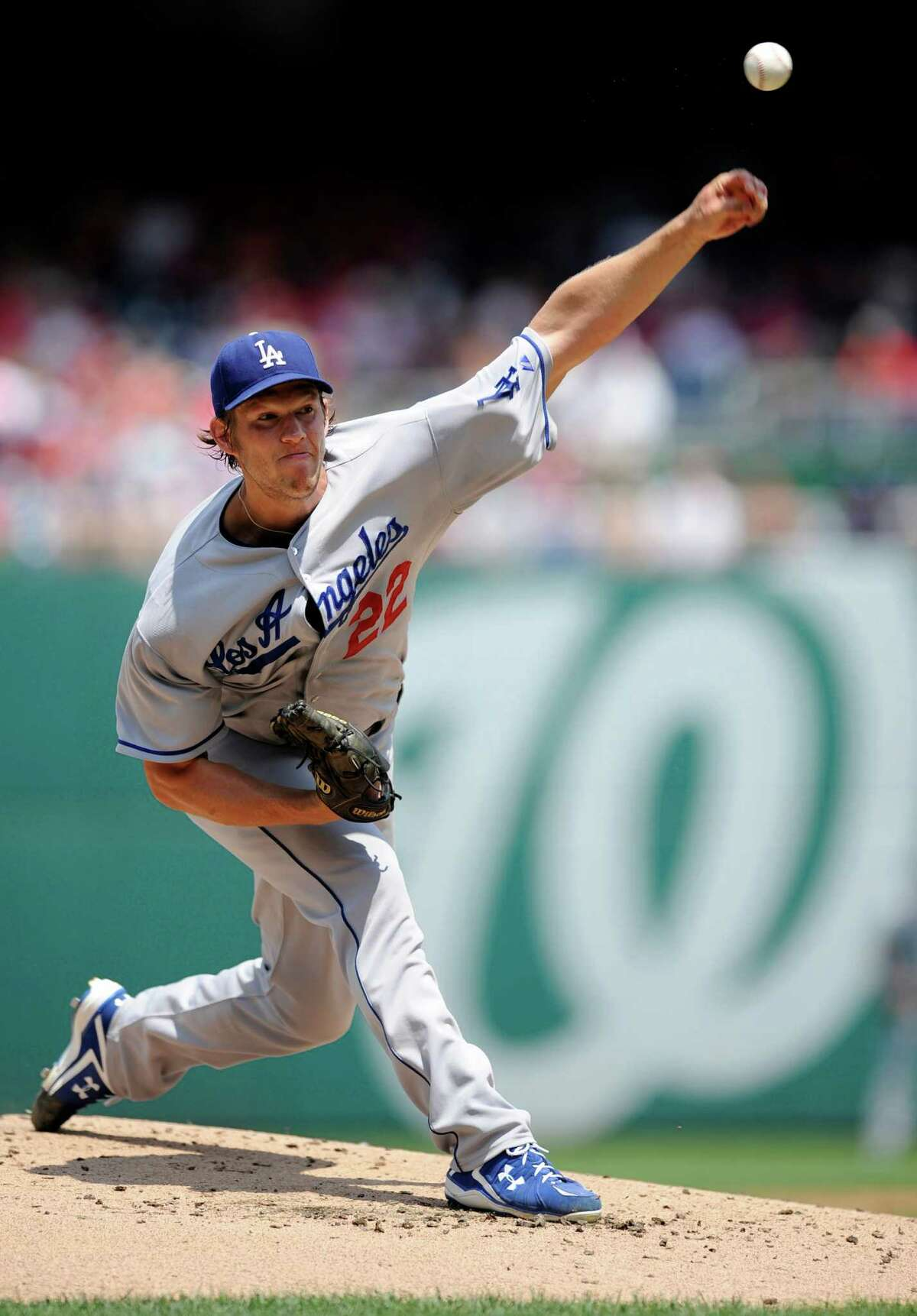 FILE - In this July 21, 2013, file photo, Los Angeles Dodgers starting pitcher Clayton Kershaw delivers a pitch against the Washington Nationals during the first inning of a baseball game in Washington. Kershaw won the National League Cy Young Award, Wednesday, Nov. 13, 2013. (AP Photo/Nick Wass, File) ORG XMIT: NY181