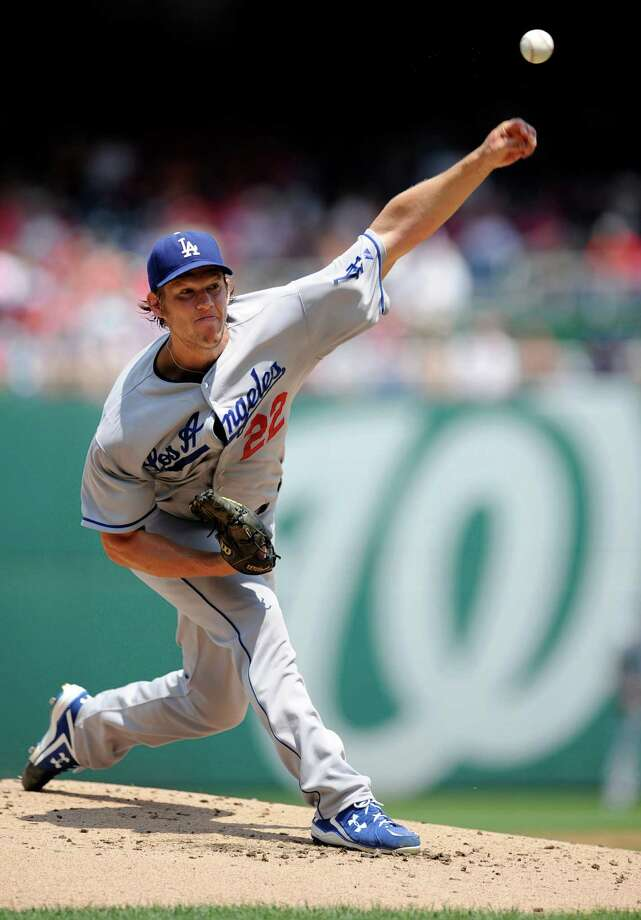 FILE - In this July 21, 2013, file photo, Los Angeles Dodgers starting pitcher Clayton Kershaw delivers a pitch against the Washington Nationals during the first inning of a baseball game in Washington. Kershaw won the National League Cy Young Award, Wednesday, Nov. 13, 2013. (AP Photo/Nick Wass, File) ORG XMIT: NY181 Photo: Nick Wass / FR67404 AP