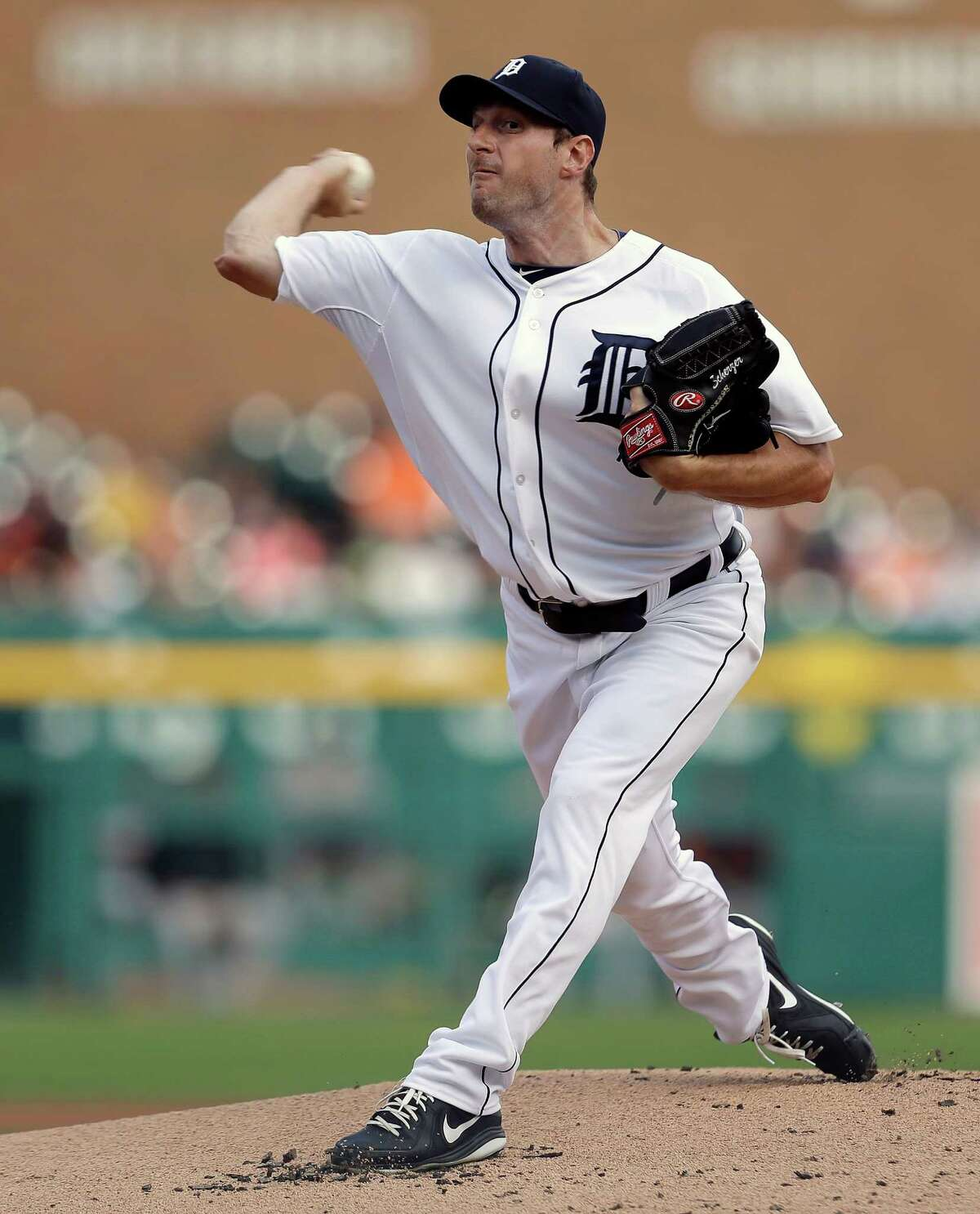 FILE - In this June 17, 2013, file photo, Detroit Tigers pitcher Max Scherzer throws to a Baltimore Orioles batter during a baseball game in Detroit. Scherzer won the American League Cy Young Award on Wednesday, Nov. 13, 2013. (AP Photo/Paul Sancya, File) ORG XMIT: NY179