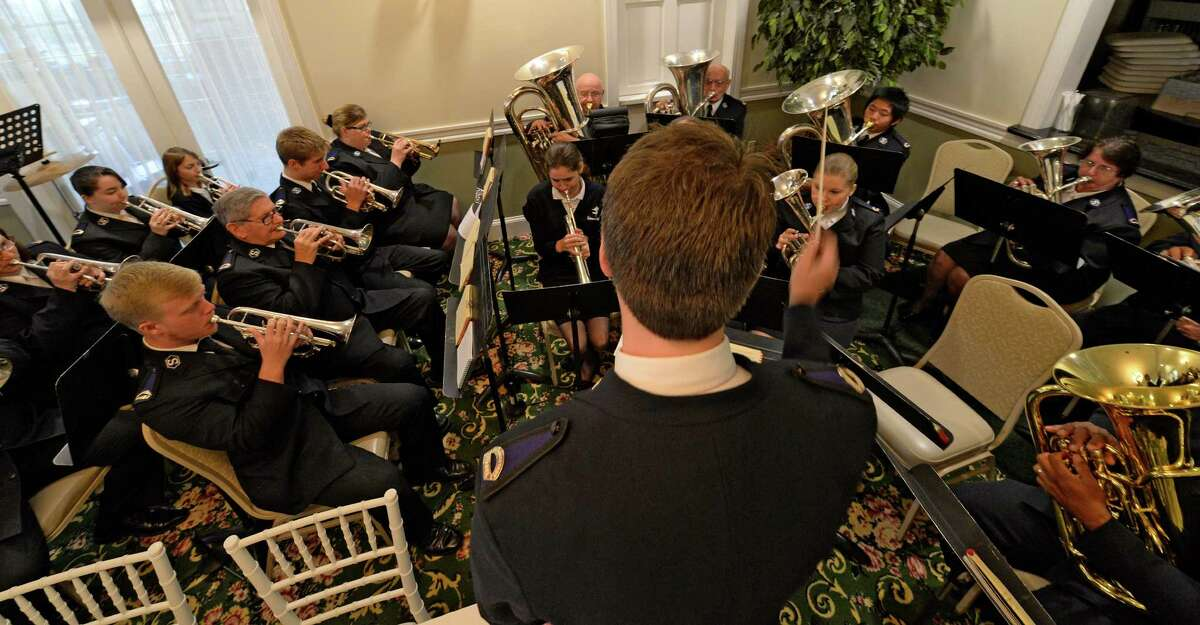 Bandmaster Erik Jones leads the band in God Bless American at the Salvation Army Kettle Kick-off Breakfast Wednesday morning Nov. 13, 2013 at the River Stone Manor in Glenville, N.Y. (Skip Dickstein/Times Union)