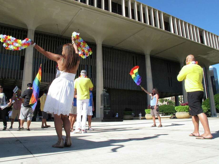 Supporters of same-sex marriage rally outside Hawaii's Capitol in Honolulu ahead of a Senate vote on whether to legalize the issue. Photo: Oskar Garcia / Associated Press
