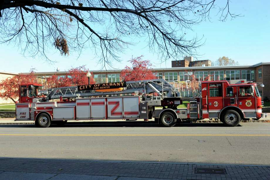 A City of Albany fire engine is parked across the street from the South End fire house on South Pearl St.  on Wednesday, Nov. 13, 2013 in Albany, N.Y. (Lori Van Buren / Times Union) Photo: Lori Van Buren / 00024637A