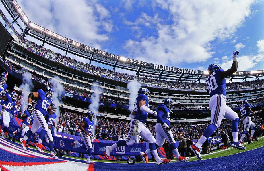 EAST RUTHERFORD, NJ - NOVEMBER 10:  The New York Giants run onto the field prior to their game against the Oakland Raiders during their game at MetLife Stadium on November 10, 2013 in East Rutherford, New Jersey.  (Photo by Al Bello/Getty Images) Photo: Al Bello / 2013 Getty Images