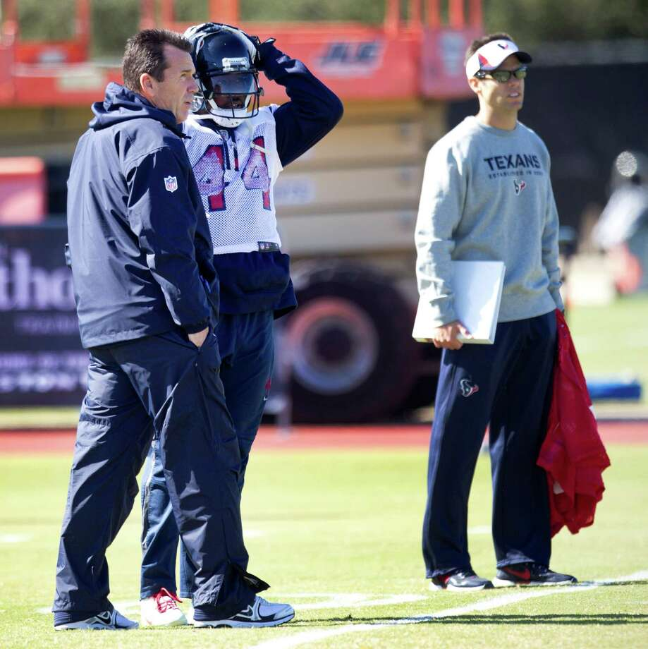 Texans coach Gary Kubiak, left, back at practice after having a mini-stroke on Nov. 3, visits Wednesday with tailback Ben Tate, who has been playing with four broken ribs. Photo: Brett Coomer, Staff / © 2013  Houston Chronicle