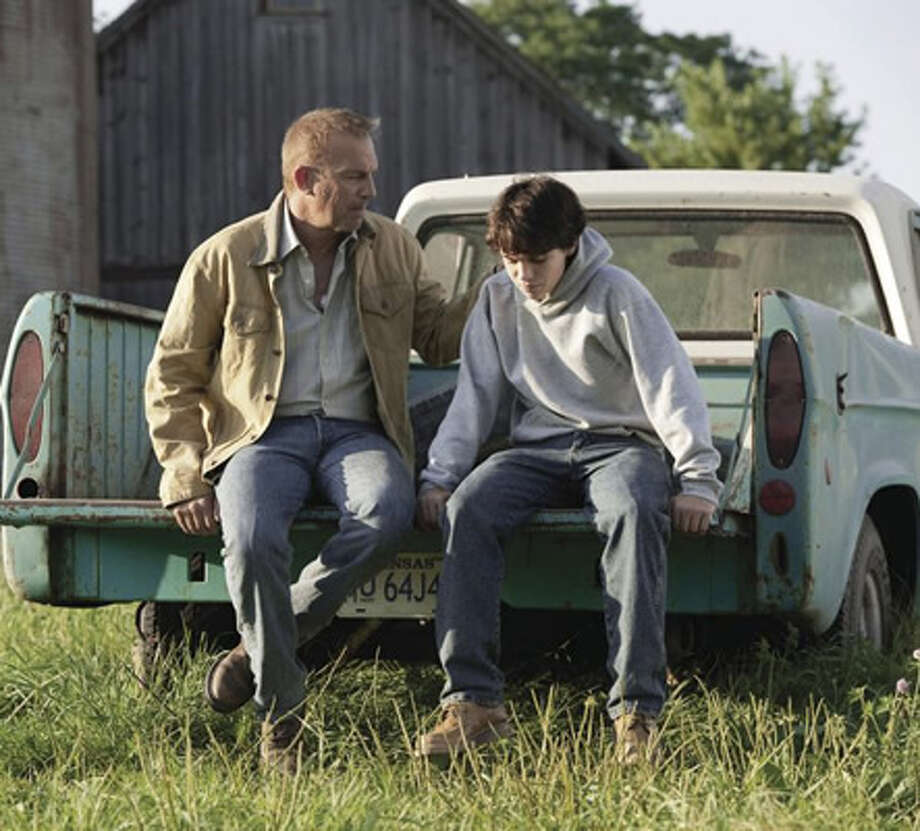 Kevin Costner as Jonathan Kent and Dylan Sprayberry as the 13-year-old Clark Kent. Photo: Warner Bros., 2013