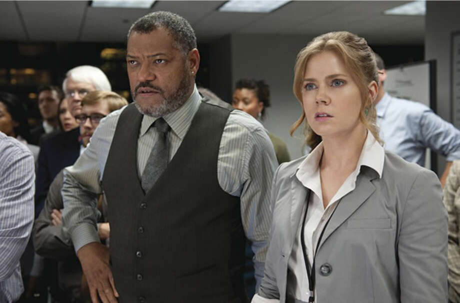 Laurence Fishburne as Perry White and Amy Adams as Lois Lane. Photo: Warner Bros., 2013