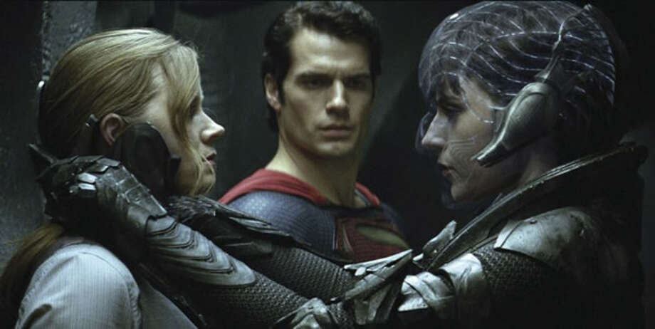 Amy Adams as Lois Lane, Henry Cavill as Superman and Antje Traue as Faora-Ul. Photo: Warner Bros., 2013