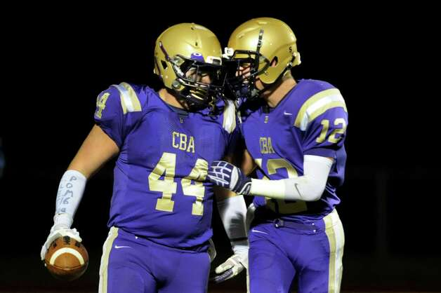 CBA's Max Anthony, left, celebrates a touchdown with teammate Ryan O'Hagan during their Class AA semifinal football game against Guilderland on Friday, Nov. 1, 2013, at Christian Brothers Academy in Colonie, N.Y. (Cindy Schultz / Times Union) Photo: Cindy Schultz / 00024470A
