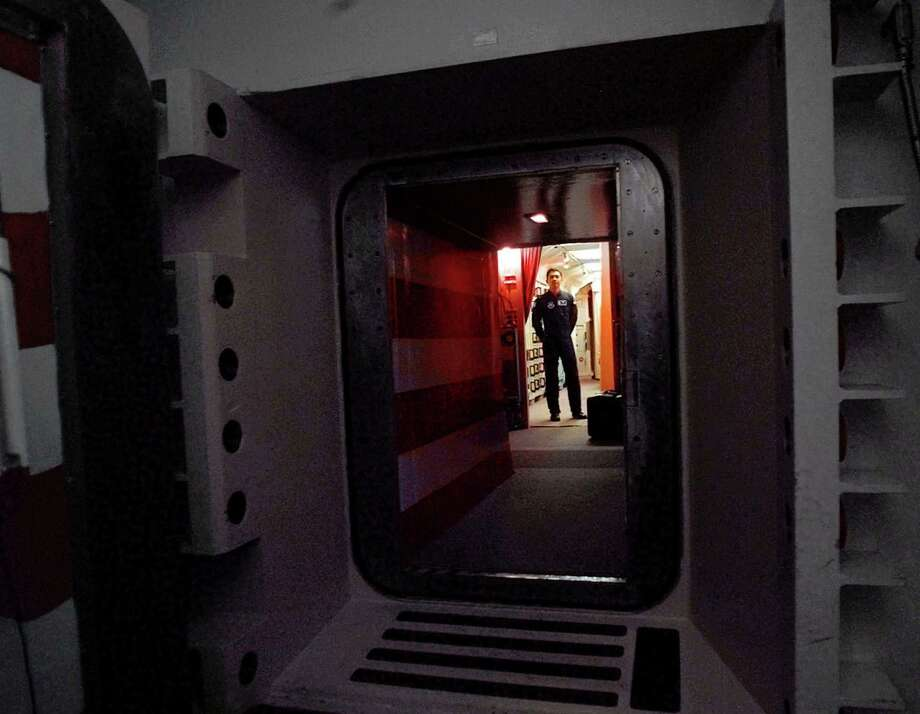 In a photo from 1997, an Air Force missile crew commander stands at the door of his launch capsule 100 feet underground, where he is responsible for 10 nuclear-armed ICBM's in north-central Colorado. Photo: Associated Press