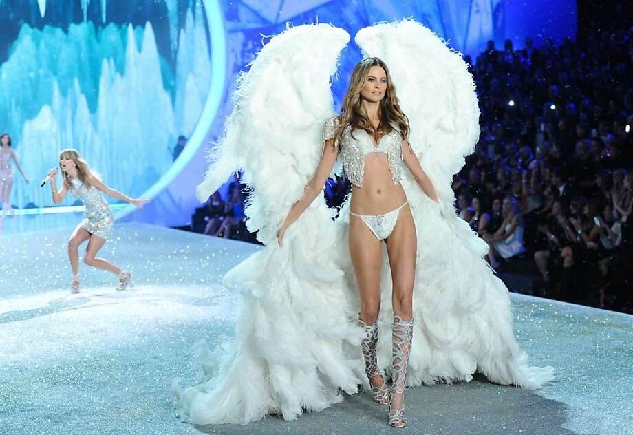 Model Behati Prinsloo walks the runway while Taylor Swift performs during the 2013 Victoria's Secret Fashion Show at the 69th Regiment Armory on Wednesday, Nov. 13, 2013 in New York. (Photo by Evan Agostini/Invision/AP) Photo: Evan Agostini, Associated Press