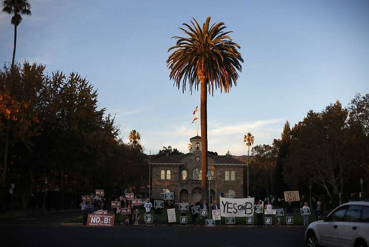Supporters on both sides of Measure B protest outside of Sonoma City Hall, Wednesday November 13, 2013, in Sonoma, Calif.
