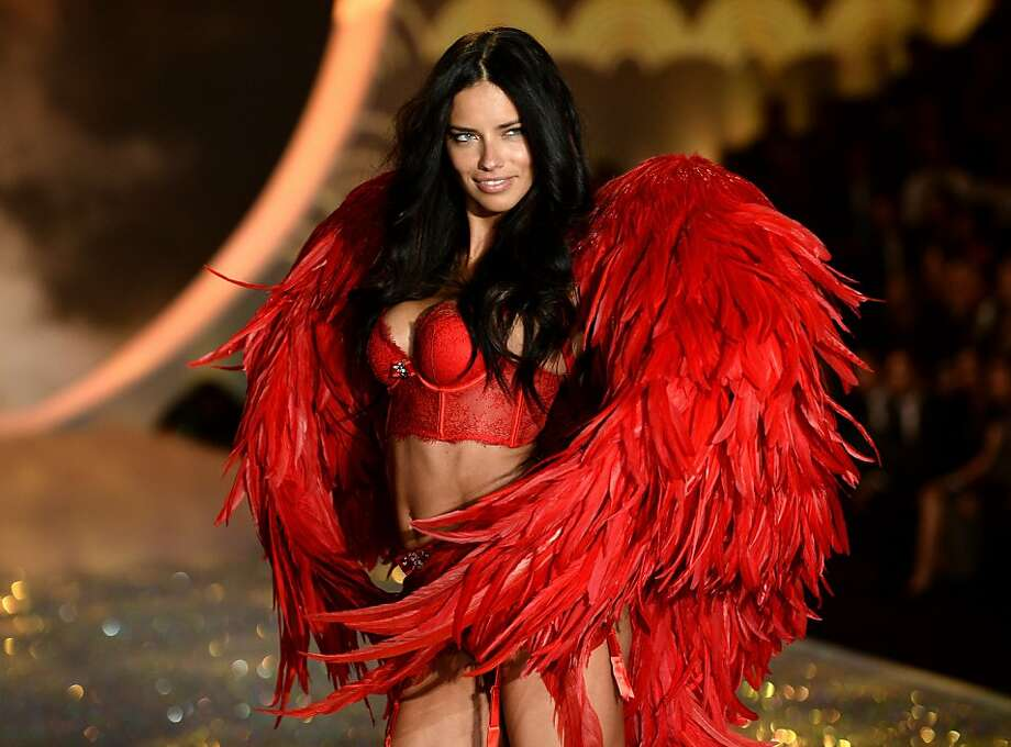 Model Adriana Lima walks the runway at the 2013 Victoria's Secret Fashion Show at Lexington Avenue Armory on November 13, 2013 in New York City.  (Photo by Dimitrios Kambouris/Getty Images for Victoria's Secret) Photo: Dimitrios Kambouris, (Credit Too Long,  See Caption)