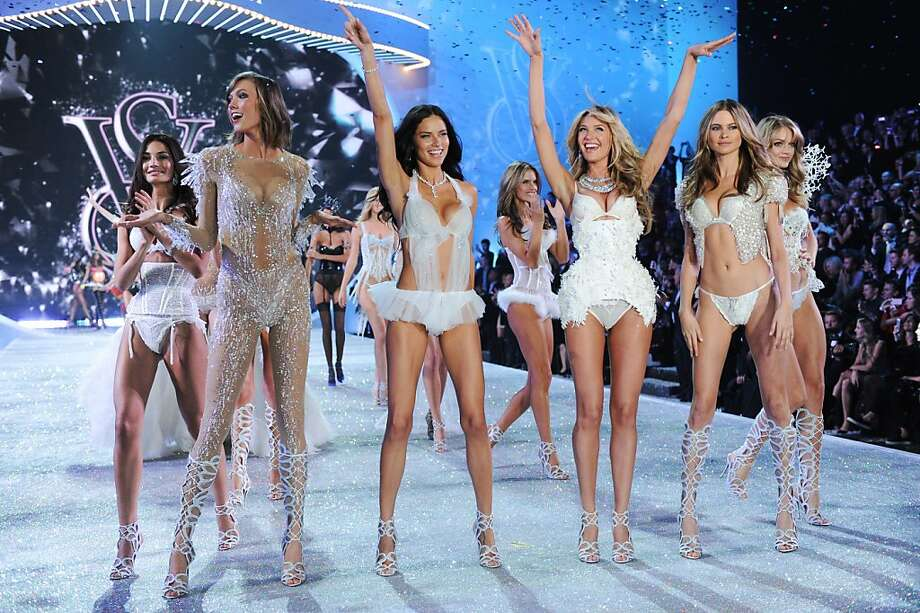 Models, from left, Lily Aldrige, Karlie Kloss, Adriana Lima, Candice Swanepoel and Bahati Prinsloo walk the runway during the finale of the 2013 Victoria's Secret Fashion Show at the 69th Regiment Armory on Wednesday, Nov. 13, 2013, in New York. (Photo by Evan Agostini/Invision/AP) Photo: Evan Agostini, Associated Press