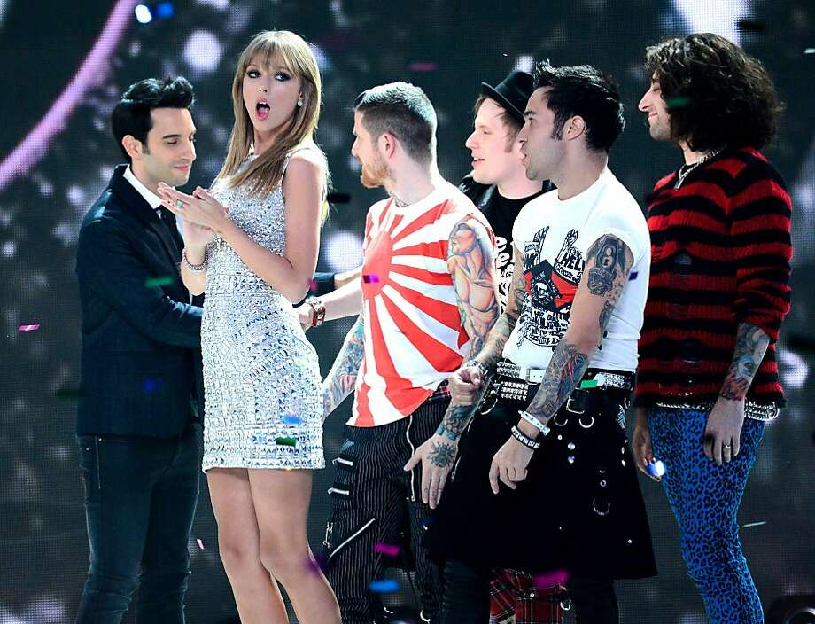 Singer Taylor Swift, second left, and the members of Fall Out Boy celebrate during the finale of the 2013 Victoria's Secret Fashion Show at the 69th Regiment Armory on Wednesday, Nov. 13, 2013, in New York. (Photo by Evan Agostini/Invision/AP) Photo: Evan Agostini, Associated Press