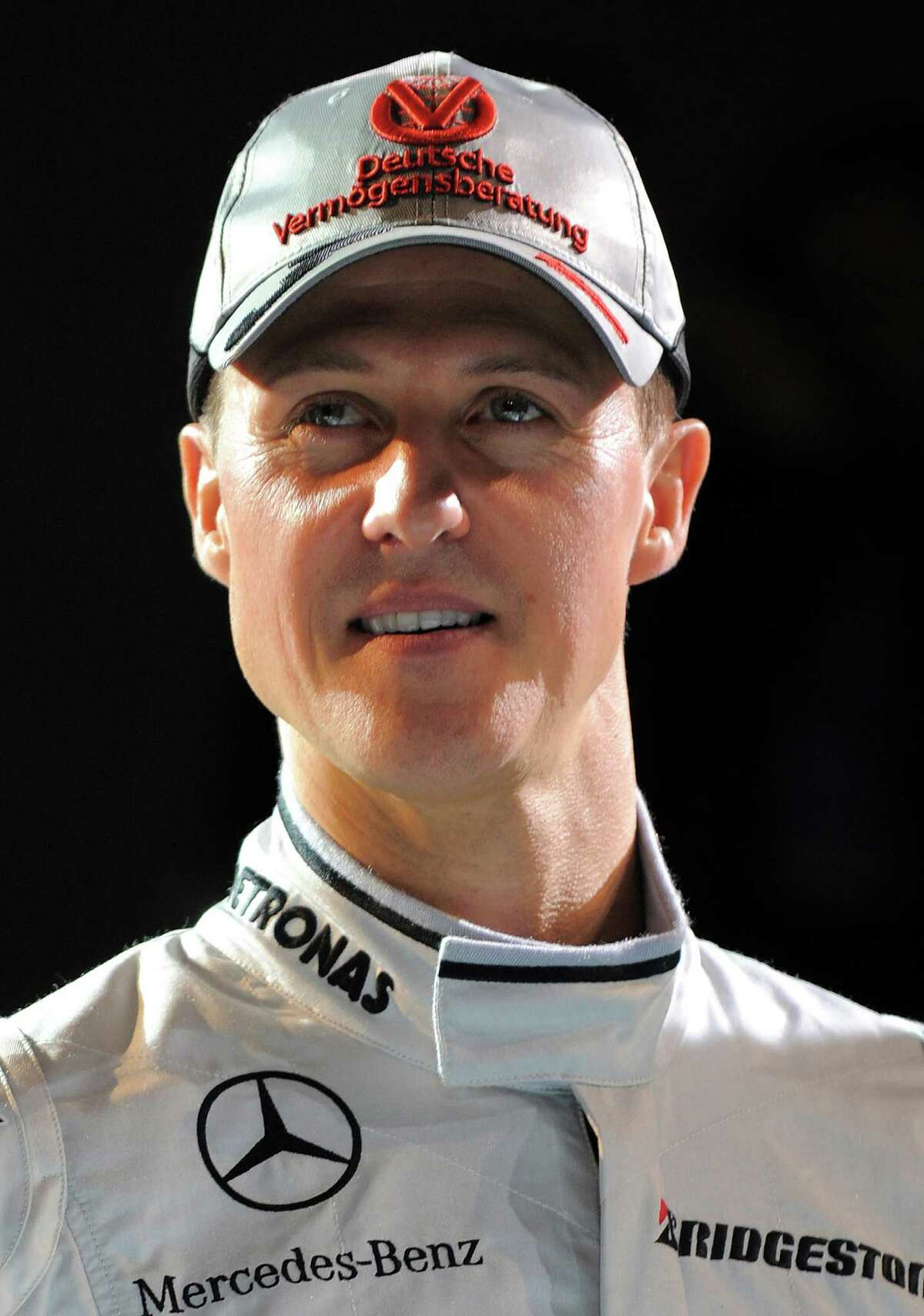 German seven-time world champion Michael Schumacher poses during the presentation of the new Mercedes GP Petronas Formula 1 team, at the Mercedes Museum in Stuttgart, southern Germany, on January 25, 2010. Having retired in 2006, the 41-year-old broke his three-year hiatus to sign a three-year contract to race for Mercedes GP and reunite with Ross Brawn, the man who orchestrated all of his world drivers' championship titles. AFP PHOTO / Patrick HERTZOG (Photo credit should read PATRICK HERTZOG/AFP/Getty Images)
