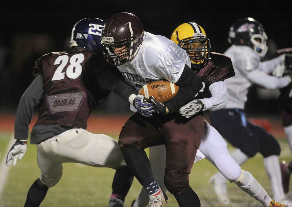The north and south teams face off in the 2013 Section 2 Exceptional Seniors Football game at Shenendehowa High School on Wednesday Nov. 13, 2013 in Clifton Park, N.Y. (Michael P. Farrell/Times Union)