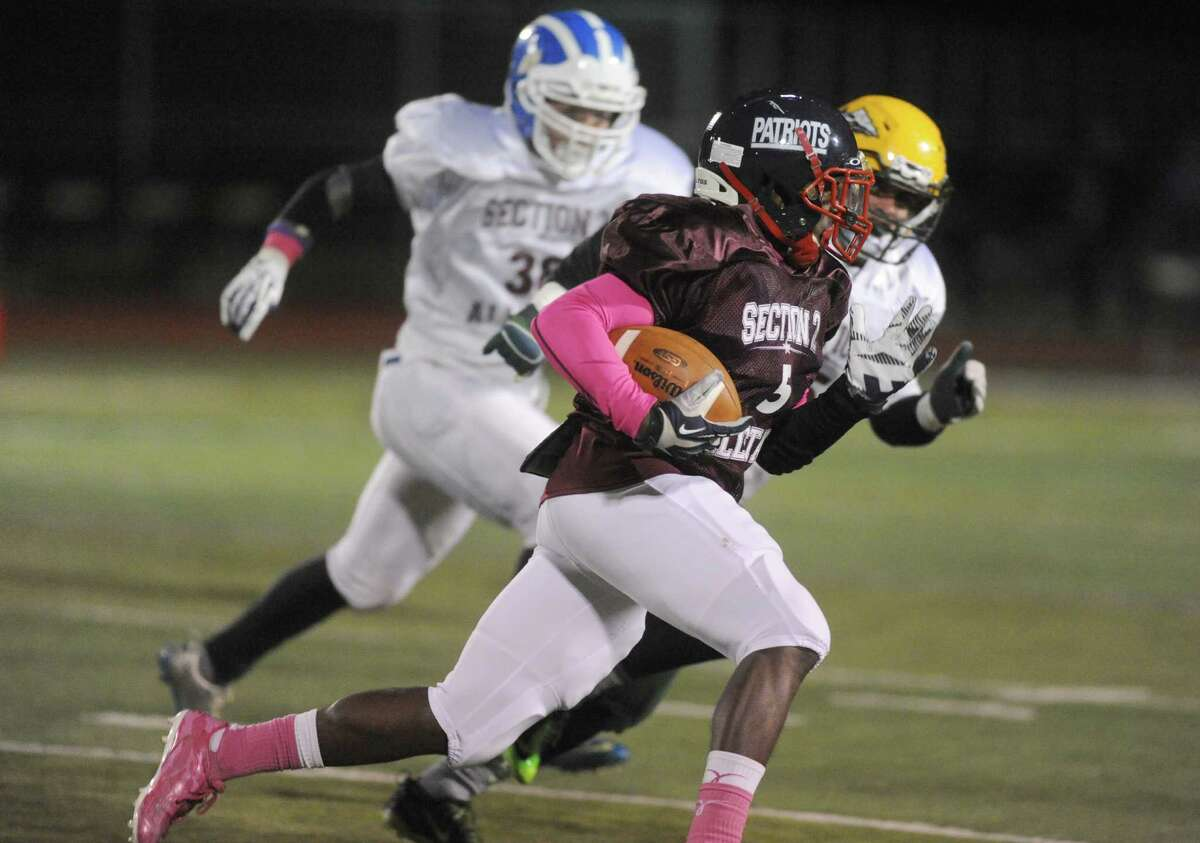 The north and south teams faceoff in the 2013 Section 2 Exceptional Seniors Football game at Shenendehowa High School on Wednesday Nov. 13, 2013 in Clifton Park, N.Y. (Michael P. Farrell/Times Union)