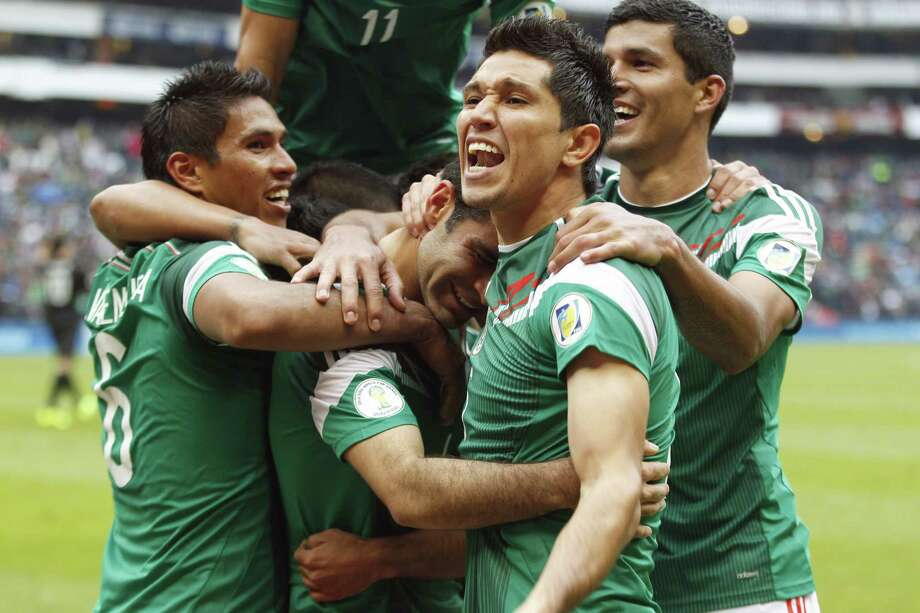 Rafael Marquez (center) and his Mexico teammates were in high spirits after Marquez scored his team's fifth goal in the 84th minute Wednesday. Photo: Eduardo Verdugo / Associated Press
