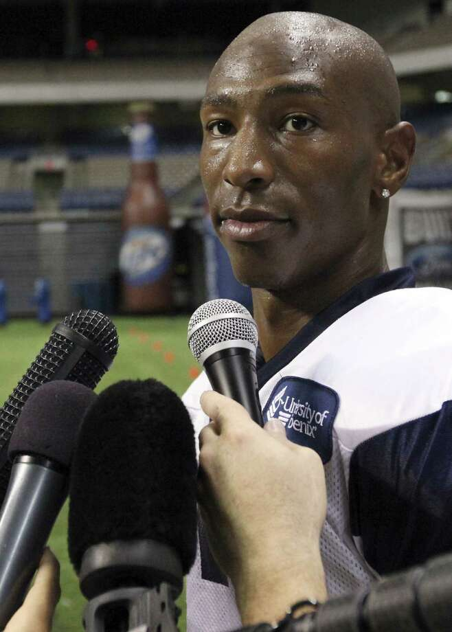 Former Dallas Cowboy Sam Hurd was sentenced to 15 years in prison for his role in a drug-pushing scheme while playing for the Chicago Bears,completing a steep downfall. Photo: San Antonio Express-News File Photo