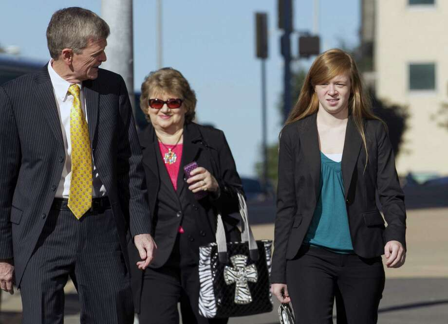 Abigail Fisher (right) arrives at the Homer Thornberry Judicial Building in Austin for a hearing in her case against the University of Texas, in which she claims that it improperly denied her admission because of race. Photo: Jay Janner / Austin America-Statesman