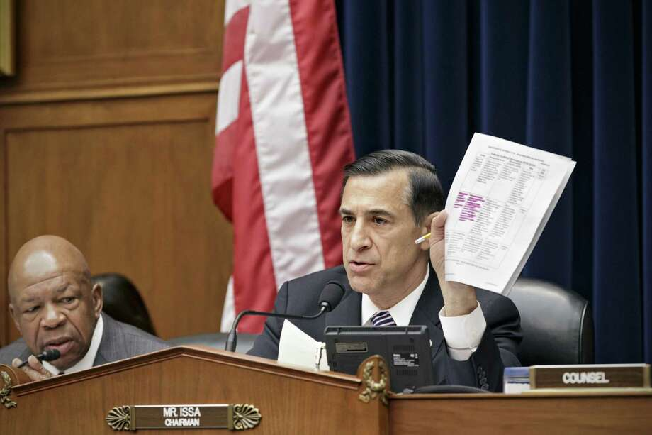 House Oversight Committee Chairman Darrell Issa, R-Calif., holds up a document during a hearing on the problems with Obamacare. Photo: J. Scott Applewhite / Associated Press