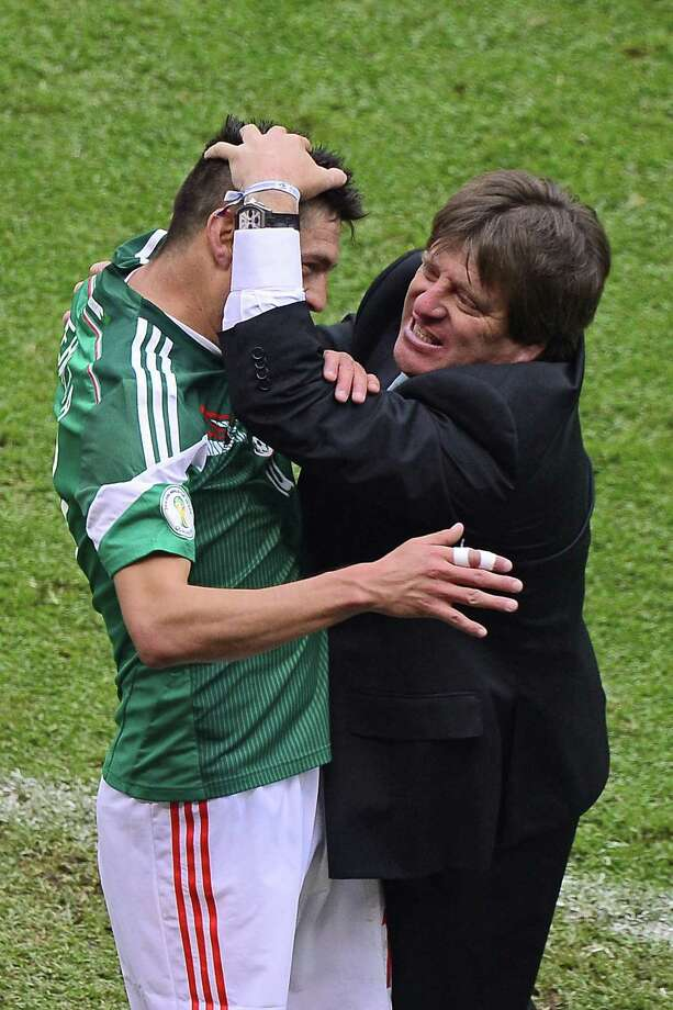 The moves by new Mexican coach Miguel Herrera, right, were a smashing success as Oribe Peralta, left, scored twice in the 5-1 win over New Zealand that virtually assures a World Cup berth. Photo: RONALDO SCHEMIDT, Staff / AFP