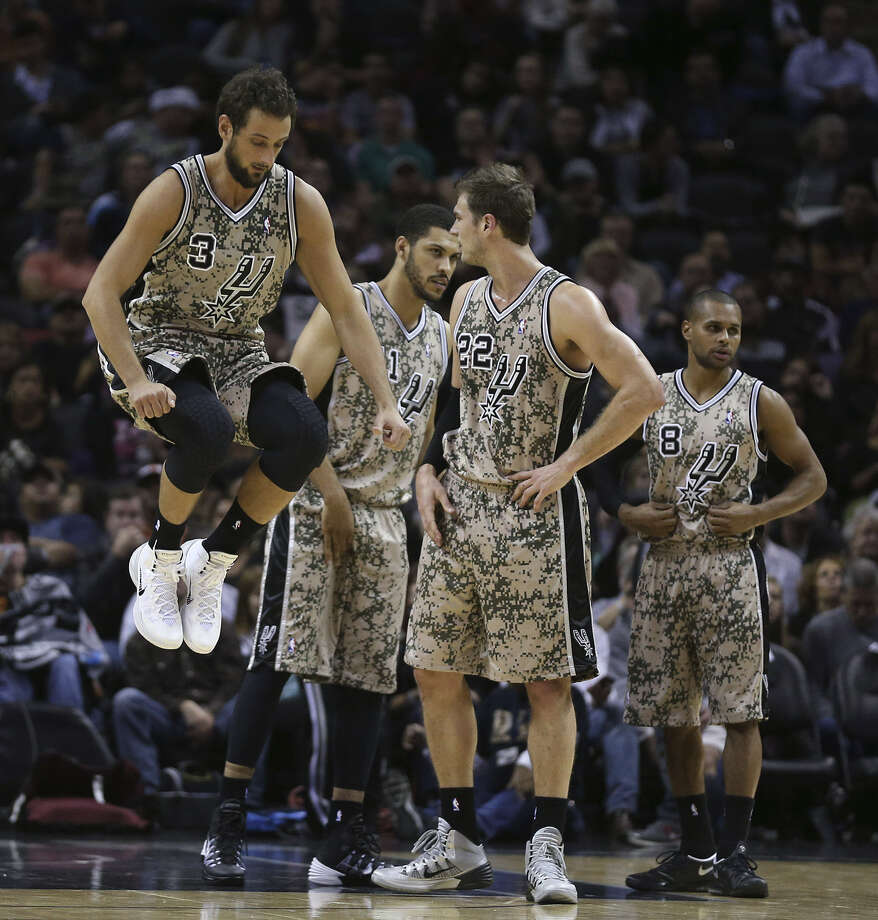 Marco Belinelli (from left), Jeff Ayres, Tiago Splitter and Patty Mills prepare for action to resume Wednesday night at the AT&T Center. Photo: Jerry Lara / San Antonio Express-News
