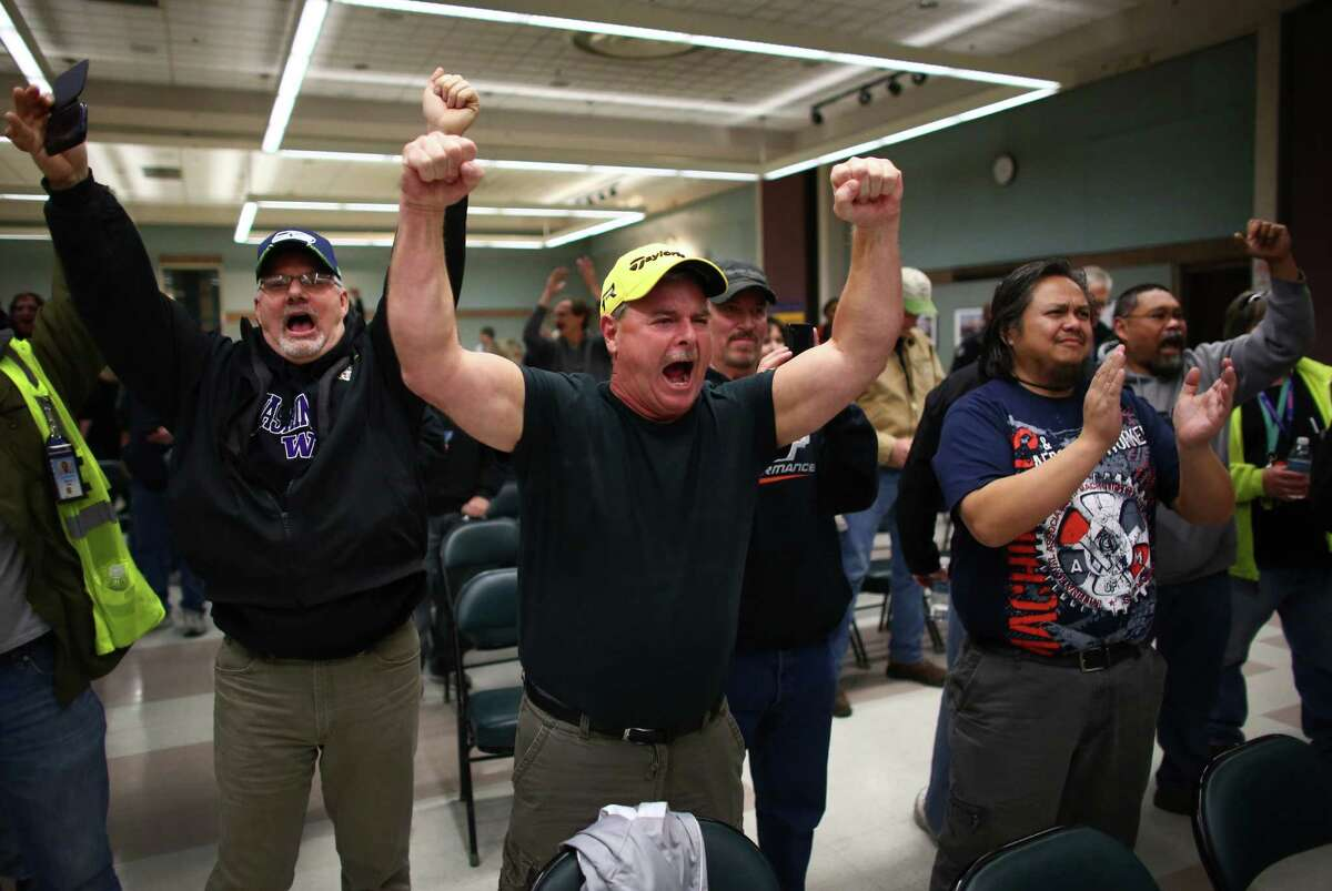 Boeing machinists react as the results of a vote are read at the International Association of Machinists union hall in Seattle on Wednesday, November 13, 2013. IAM members voted and turned down a contract extension that would have cut pension and benefits in exchange for Boeing's commitment to build the 777X in Washington State.
