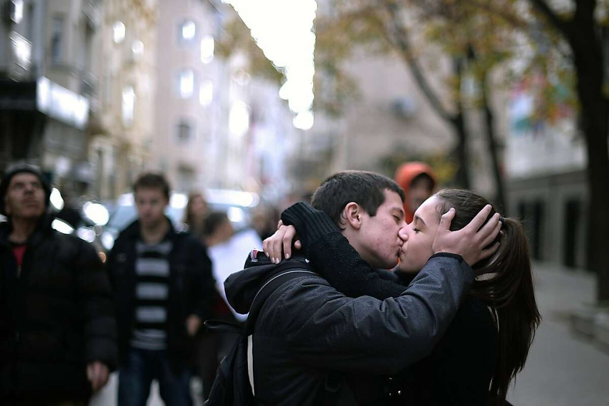 TOPSHOTS A young Bulgarian couple kiss during an anti-government protest in downtown Sofia on November 13, 2013. Forty-eight people were arrested and four, including a police officer, were injured in clashes that broke out during an anti-government protest in Sofia to press for the resignation of Prime Minister Plamen Oresharski's Socialist-backed government, Bulgarian police said. TOPSHOTS/AFP PHOTO / DIMITAR DILKOFFDIMITAR DILKOFF/AFP/Getty Images